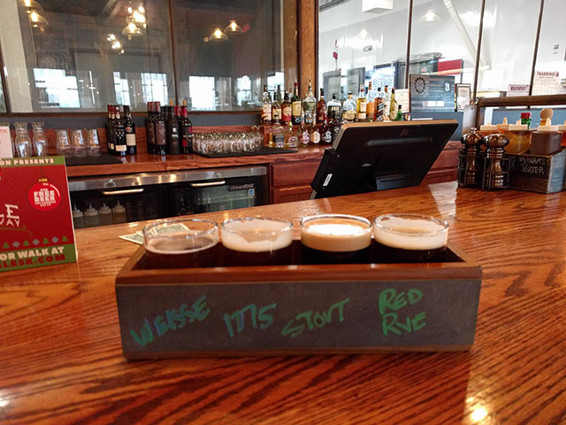 A flight of craft beer - stout, weisse, and ale