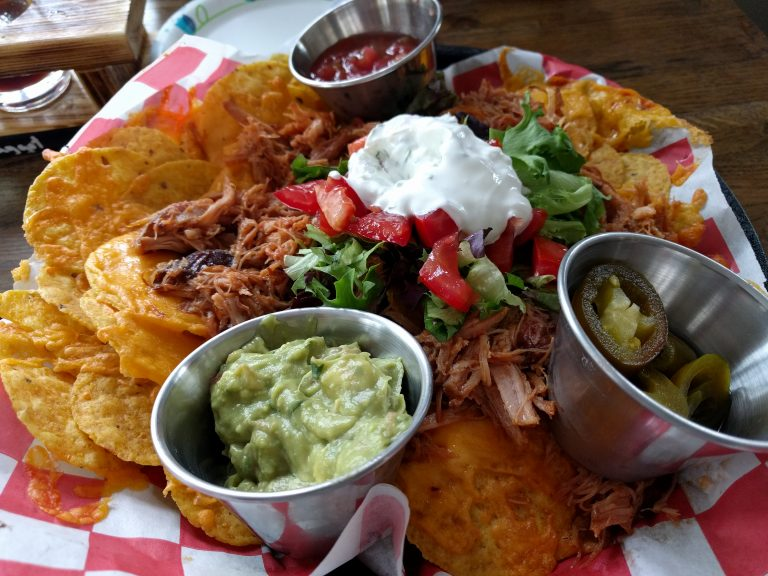 Burnt Timber Brewing pulled pork nachos with salsa, sour cream, and guacamole.