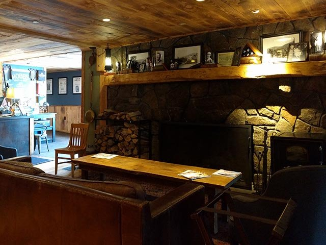The comfy couch by the fireplace in the Hobbs Tavern